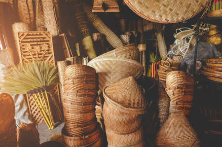 Hand made bamboo basketry appliance stock with indoor low and warm lighting.
