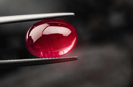 Red ruby gemstone  with dark blackground.