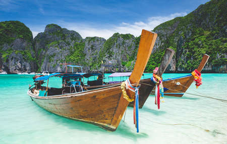 Andaman sea Phi phi leh maya island and longtail boat with sun lighting.