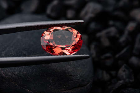 Oval red garnet gemstone  with dark blackground.