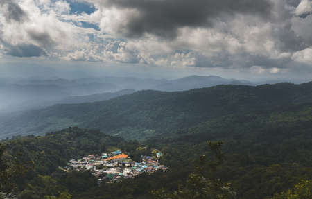 Tribal village town on the top of mountain in the north of Thailand with cloud sky low lighting.