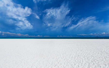 White sand beach  with clouds and blue sky sun lighting.