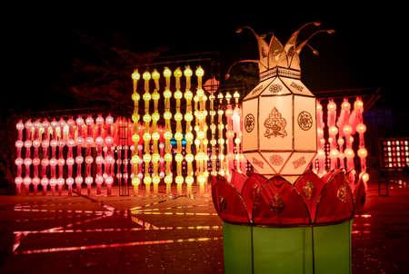 Colorful Loy krathong festival street lanterns in Thailand public night time.