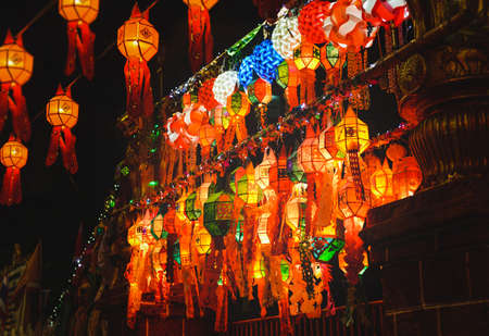 Colorful Loy krathong festival street lanterns in Thailand public night time.