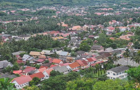 Top view of Luangprabang city in Laos with outdoor cloud and low lighting.