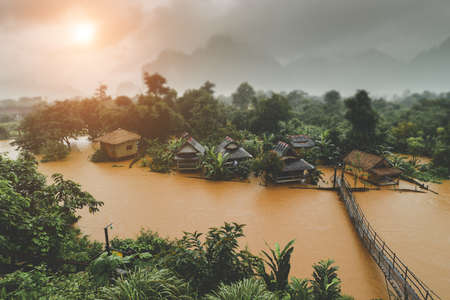 Country side village in floating river and the raining fog weather low and warm lighting. 版權商用圖片 - 164058813