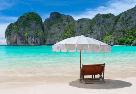 Blue sea island beach and relax chair with umbrella.