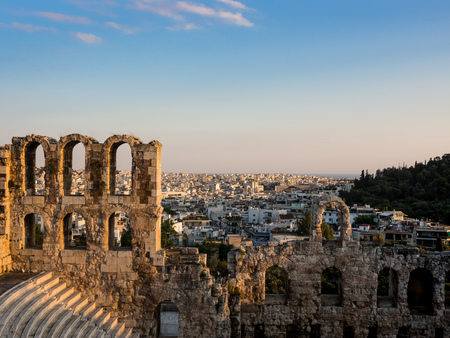 Odeon of Herodes Atticus arches and rows of seats of southern slope of Acropolis in Athens, Greece in soft light of a summer sunset Foto de archivo