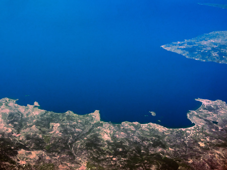 Aerial view of seashores of Greece shot from airplane