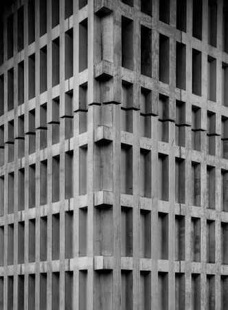 Concrete corner of a building with modern rhythmic pattern of blocks