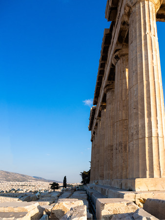 Columns of Parthenon temple on Acropolis, Athens of Greece at sunset against blue sky