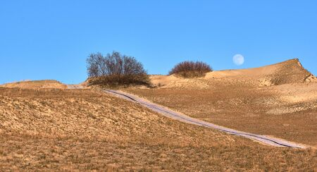 View of nordic sand dunes and pathways, Baltic sea at Curonian spit, Nida, Klaipeda, Lithuania