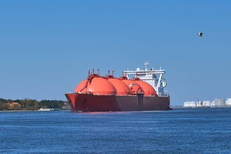 LNG or liquified natural gas tanker entering port on a sunny day in Klaipeda, Lithuania. Alternative gas supply, commercial freight, energy crisis