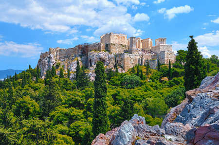 View of Acropolis hill from Areopagus hill on summer day great clouds in sky, Athens, Greece. . Propylaea, Parthenon. Standard-Bild