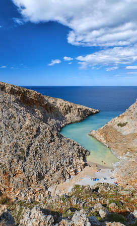Vertical view of z-shaped bay, typical Greek sunny landscape. Great blue sky, beautiful clouds. Seitan Limania, Akrotiri, Chania, Crete island, Greece