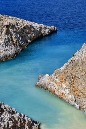 Sharp Z-shaped bay, cliffs, sea shores, crystal azure water. Natural geometry. Close shot. Seitan Limania, Akrotiri, Chania, Crete island, Greece