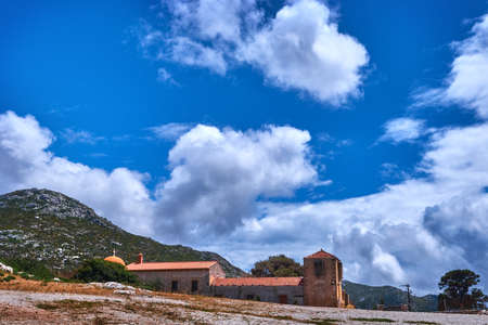 Historic remote Orthodox monastery, Greek landscape at day. Great blue sky and clouds. Gouverneto monastery, Akrotiri peninsula, Chania, Crete, Greece