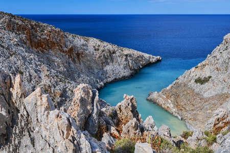 View of z-shaped bay, Greek landscape. Blue sky, beautiful clouds, sunny day. Azure sea. Seitan Limania, Akrotiri, Chania region, Crete island, Greece
