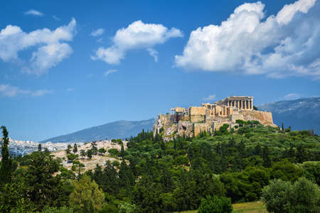 Great view of Acropolis hill from Pnyx hill on summer day with great clouds in blue sky, Athens, Greece.