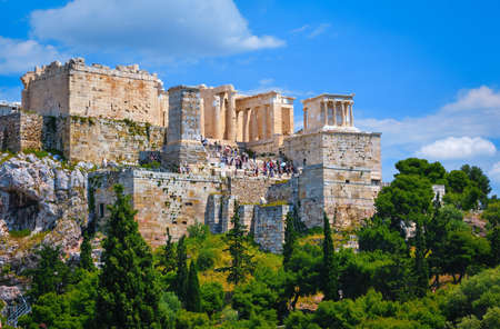 View of Acropolis hill from Areopagus hill on summer day with great clouds in blue sky, Athens, Greece.