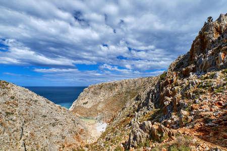 Rocky cliffs of typical Greek sea shores, blue sea, blue sky, beautiful sky. Stefanou beach, Seitan Limania, Chania region, Crete island, Greece Reklamní fotografie