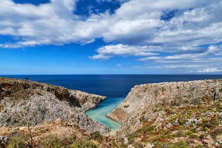View of z-shaped cove, Crete landscape. Clear blue sky, clouds, sunny day. Azure sea waters. Stefanou beach, Seitan Limania, Chania, Crete, Greece
