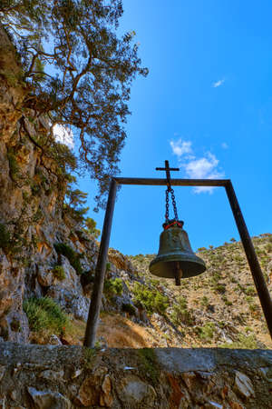 Church bell of lost Orthodox church of St John the Hermit in hills, Akrotiri, Crete, Greece. Upshot at daytime in spring. Remote christian monastery