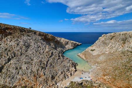 View of z-shaped bay, Crete landscape. Clear blue sky, great clouds, sunny day. Azure sea waters. Stefanou beach, Seitan Limania, Crete island, Greece Reklamní fotografie