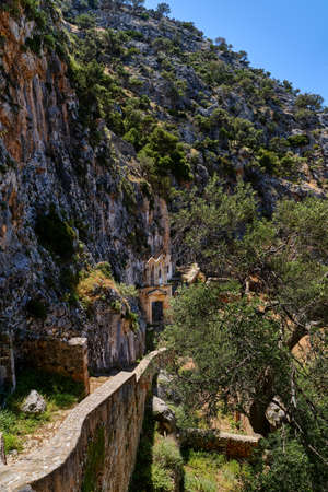Ruins of abandoned Orthodox Katholiko monastery in Avlaki gorge, Akrotiri peninsula, Chania, Crete, Greece. Ruins of entrance gate to the area. Reklamní fotografie