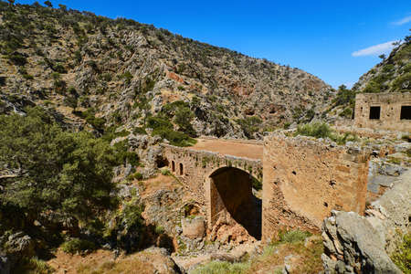 Ruins of abandoned Orthodox Katholiko monastery and bridge over Avlaki gorge, Akrotiri peninsula, Chania, Crete, Greece