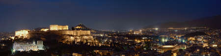 Iconic view of Acropolis hill in Athens, Greece at night. Delicate lights of Parthenon and Odeon theater. Reklamní fotografie