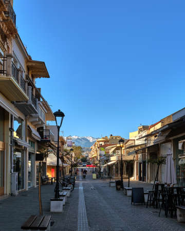 Typical street of Chania, Crete, Greece with shops, cafes and restaurants for evening promenade. No tourists, early morning. Snow on Cretan mountains Reklamní fotografie
