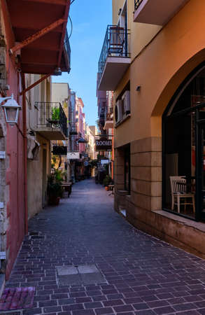 Beautiful view of empty and colorful narrow streets of old mediterranean town. Bright sunlight and deep shadows. No people. Chania, Crete, Greece