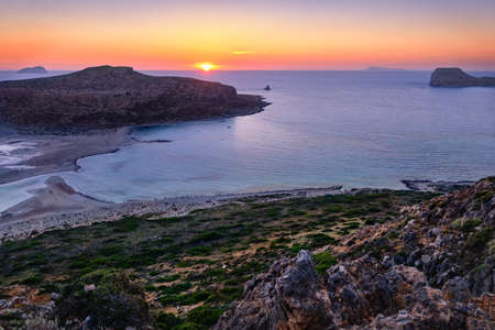 Beautiful sunset view of Cape Tigani and Gramvousa islet from Balos beach, Crete, Greece.