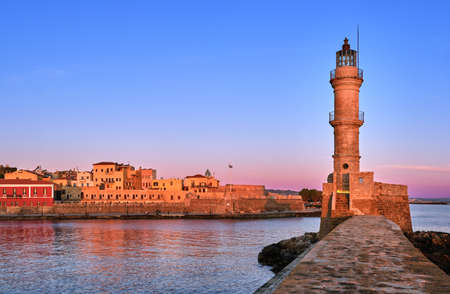 Egyptian or Venetian Lighthouse of Old Venetian harbour of Chania, Crete, Greece at sunrise. Soft sky colors from blue to pink, Firka castle walls. Reklamní fotografie