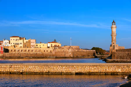 Beautiful morning view of Venetian Lighthouse, Firka castle walls and piers of Old Venetian harbour of Chania, Crete, Greece at golden hour. Reklamní fotografie