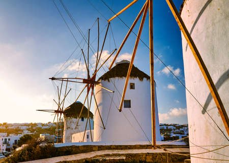 Famous tourist attraction of Mykonos, Greece. Three traditional whitewashed windmills in a row at sunrise. Summer, travel destination, iconic view.