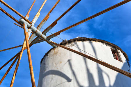 Famous tourist attraction of Mykonos, Greece. Traditional whitewashed windmill at clear blue sky. Summer, travel destination, upshot. Archivio Fotografico