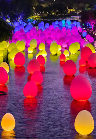 Singapore - Feb 25, 2020. Neon eggs float on water in Dragonfly lake, Gardens by the bay. Temporary event Future Together by Japanese art teamLab. Editoriali