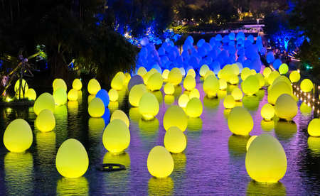 Singapore - Feb 25, 2020. Colorful blue and yellow eggs float on water in Dragonfly lake. Temporary event Future Together by Japanese art teamLab. Editoriali