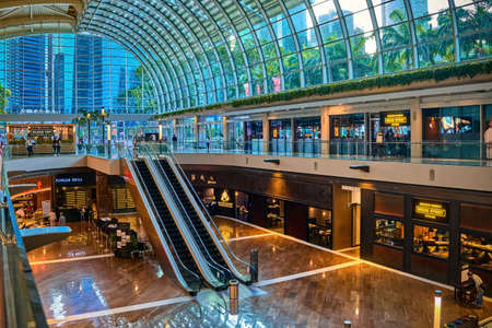 Singapore - Feb 25, 2020. Interior of entrance area in Shoppes mall and Marina Bay Sands center. Luxury shops, brands, boutiques, famous restaurants