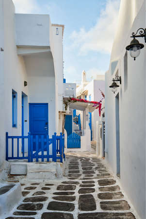 Traditional narrow cobbled streets, beautiful alleyways of Greek island towns. Whitewashed walls and houses, stairs and doors. Mykonos, Greece