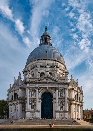 Beautiful view of iconic basilica di Santa Maria della Salute or St Mary of Health by waterfront of Grand Canal, Venice, Italy. Archivio Fotografico