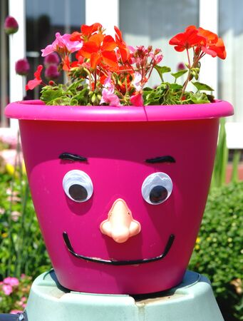 Face on A Flower Pot, Lowestoft, Suffolk. Stock Photo