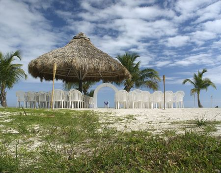 cabana: A lovely beach wedding site under a rustic tiki cabana and on a scenic outcrop