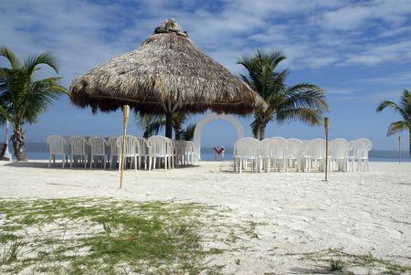 A beautiful wedding pavilion set on a tropical beach photo