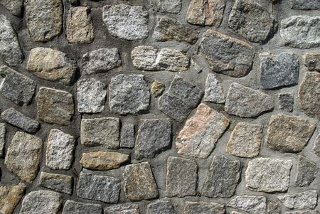A textured stone wall provides a randomly patterned background photo