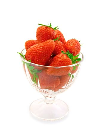Fresh strawberries in a glass on a white background