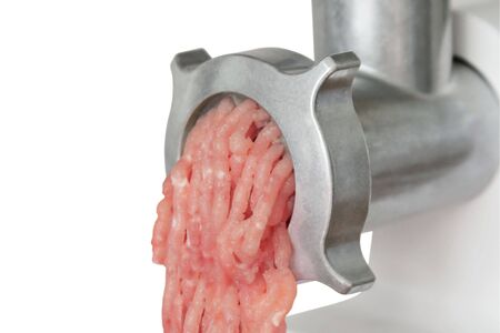Close up electrical meat grinder with chopped meat Stock Photo