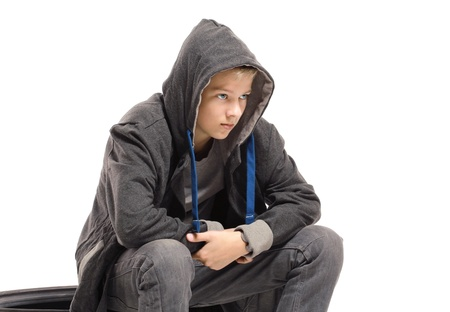 Depressed teenage boy in a jacket. Isolated on white background  Stock fotó